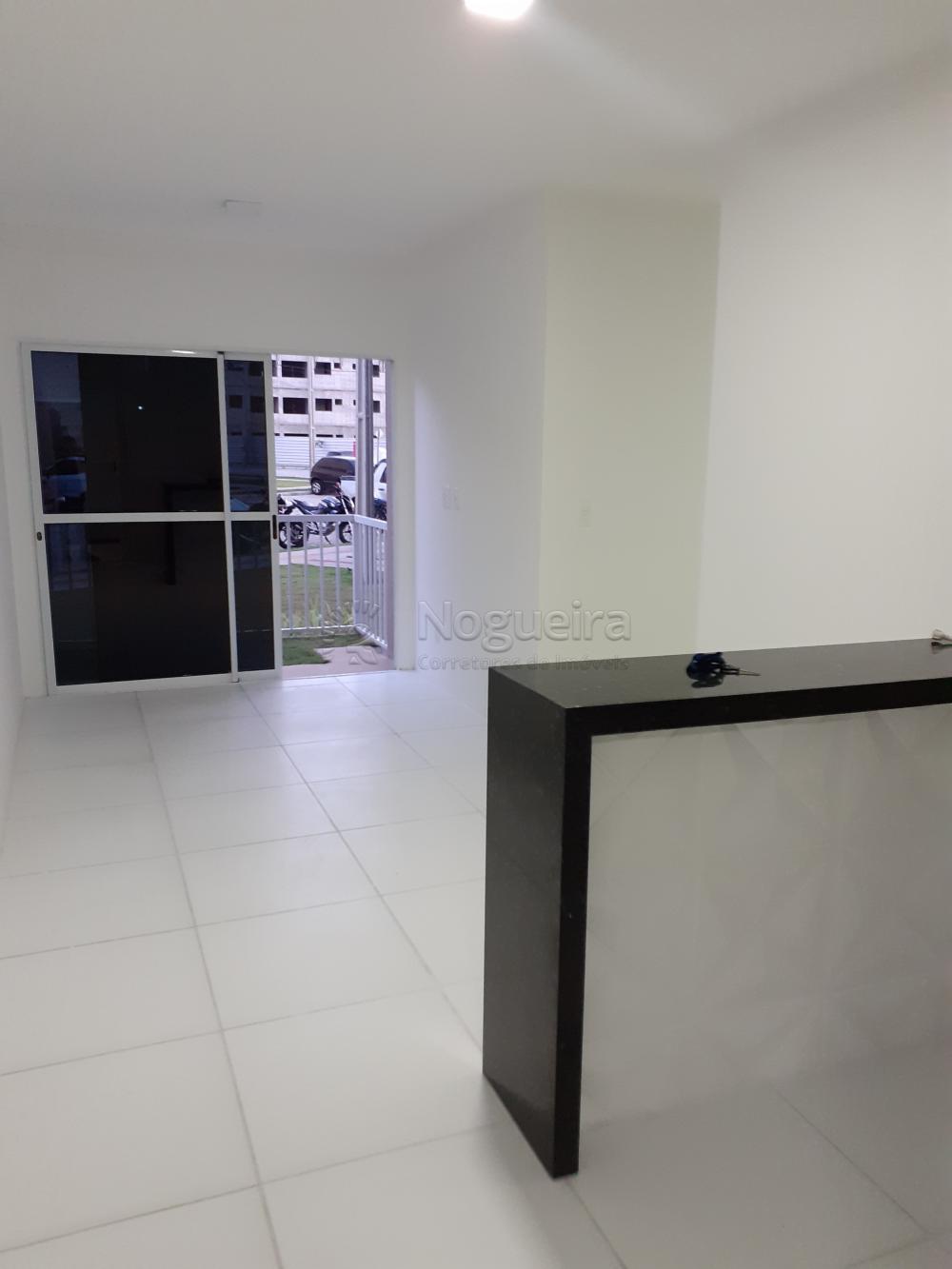 Apartamento novo em condomínio fechado com varanda, sala para 2 ambientes, 3 quartos sendo 1 suíte, banheiro social com box, cozinha e área de serviço.